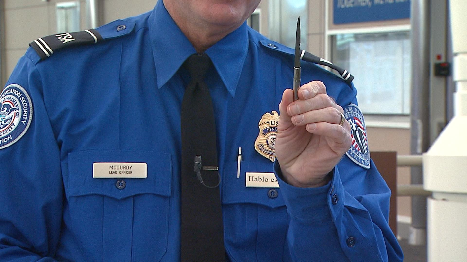 Harold McCurdy with TSA with a knife found in a pen (credit: CBS)