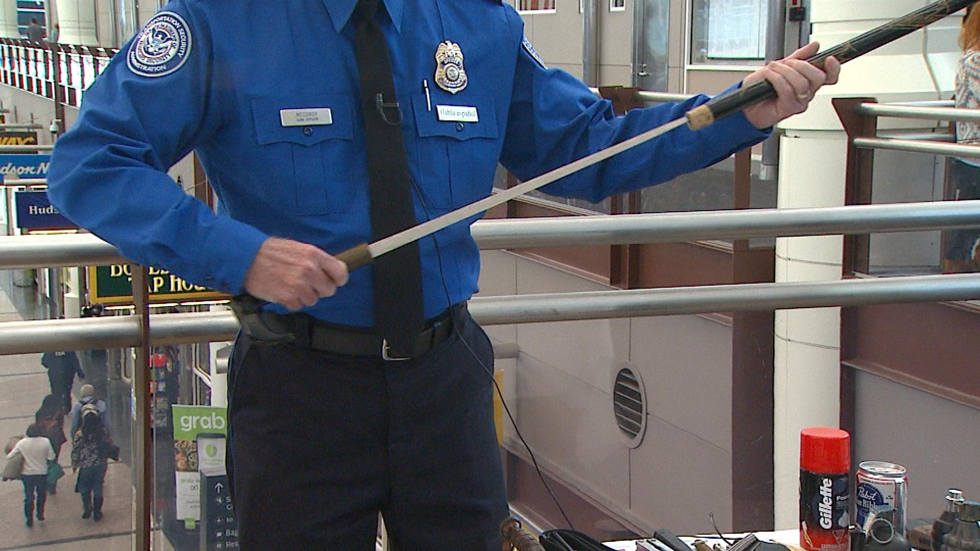 Harold McCurdy with TSA with a sword found in a cane (credit: CBS)