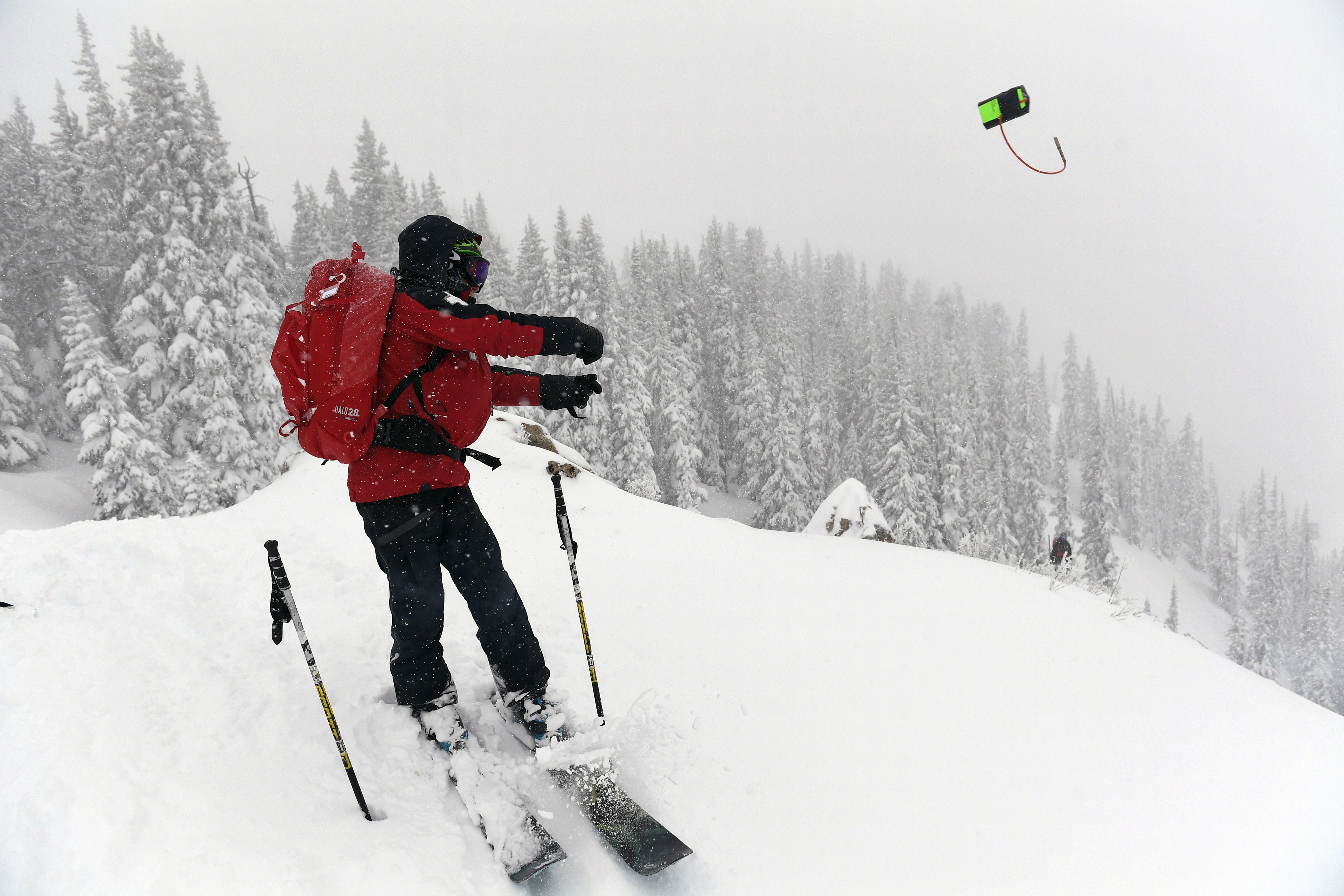 Crested Butte ski patroller Eric Mercer Baumm throws a 2 pound avalanche bomb into the deep powder in the Headwall area of Crested Butte Mountain Resort as he and other patrollers do avalanche mitigation before lifts open on the mountain on January 12, 2017. Crested Butte has been inundated with more than 100 inches of snow in the past 10 days and patrollers take great precaution to keep runs safe before opening them up to the public. More snow is expected in the upcoming days. (credit: Helen H. Richardson/The Denver Post via Getty Images)