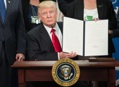 US President Donald Trump signs an executive order to start the Mexico border wall project at the Department of Homeland Security facility in Washington, DC. (credit: NICHOLAS KAMM/AFP/Getty Images)