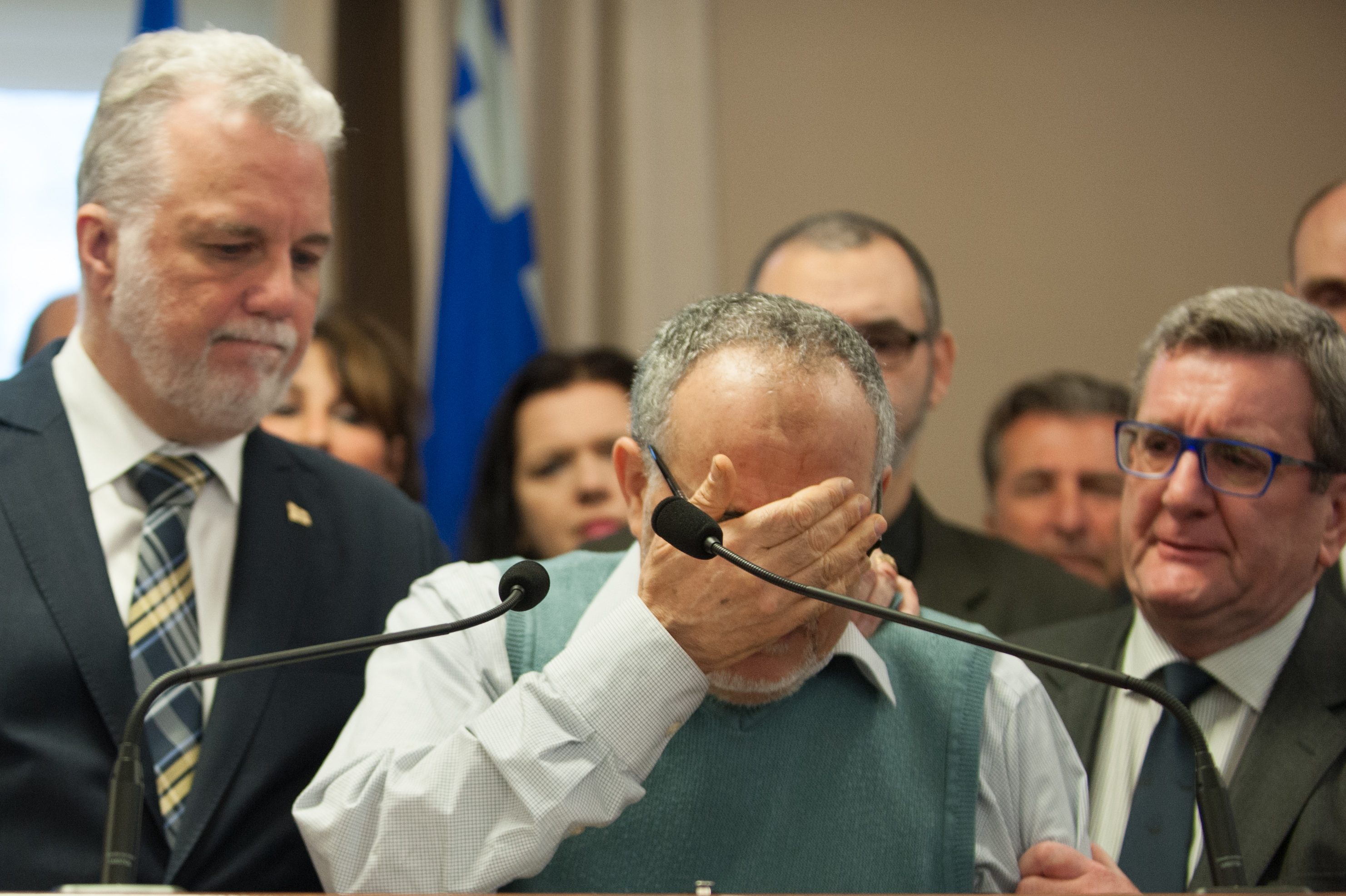 L-R: Philippe Couillard Quebec prime minister, Khaled El Kacemi, vice president of the Islamic Cultural Center of Quebec and Regis Labeaume Quebec city mayor hold a press conference (credit: ALICE CHICHE/AFP/Getty Images)