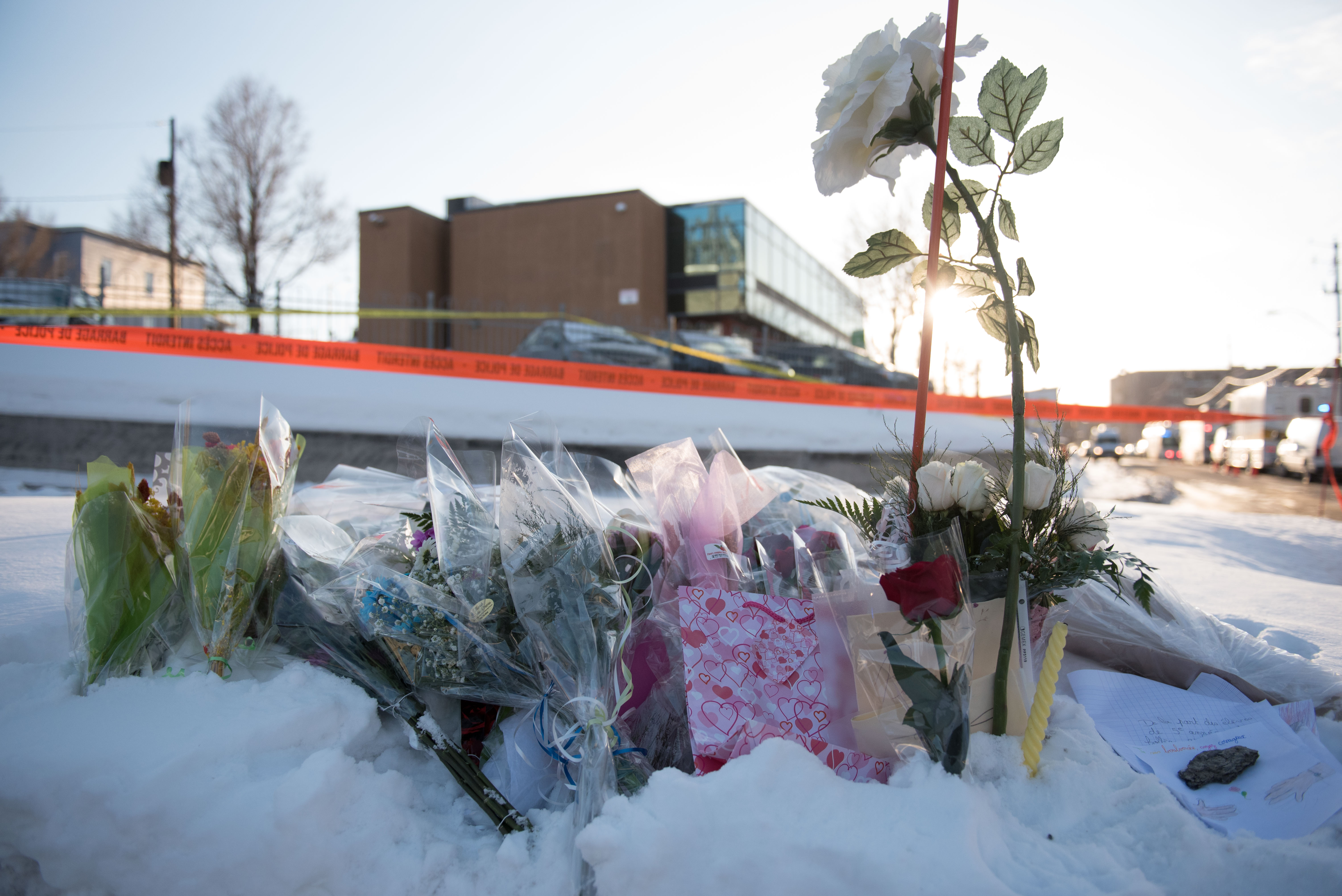 Flowers at a makeshift memorial near the Islamic Cultural Center in Quebec City, Canada (credit: ALICE CHICHE/AFP/Getty Images)