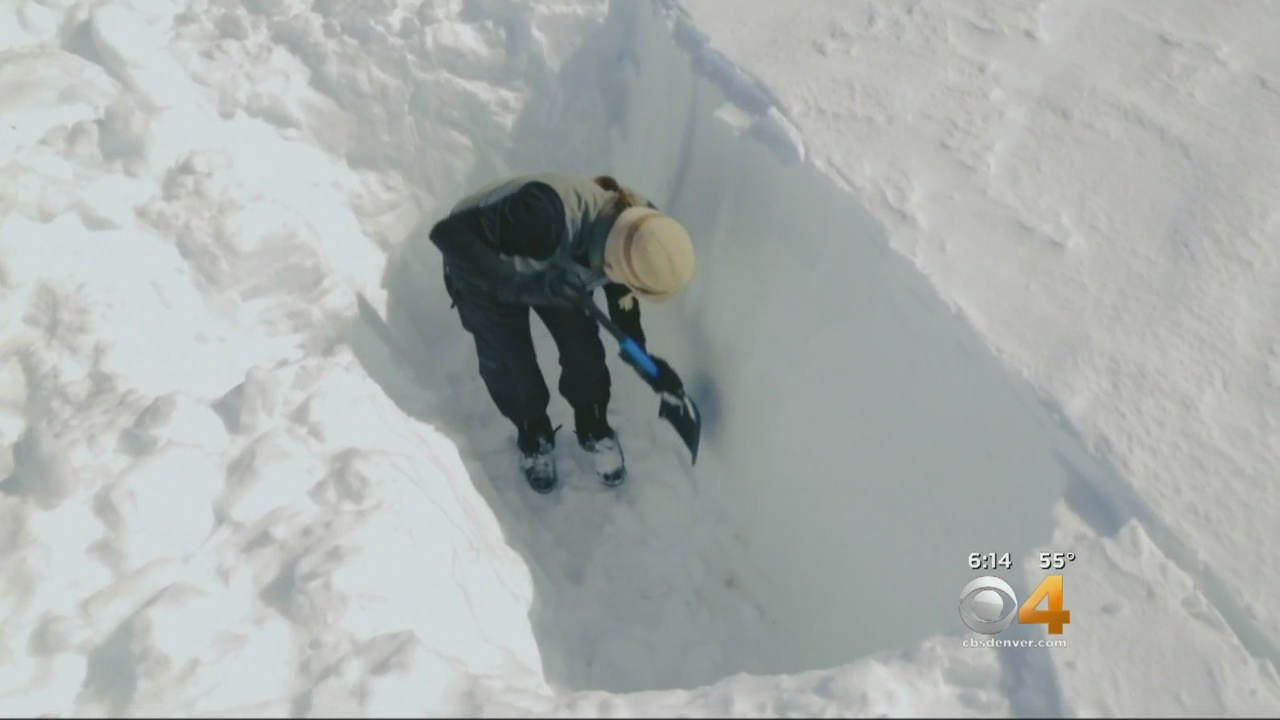 Researchers dig a snow pit to study snow water content on the Grand Mesa. (credit: CBS)