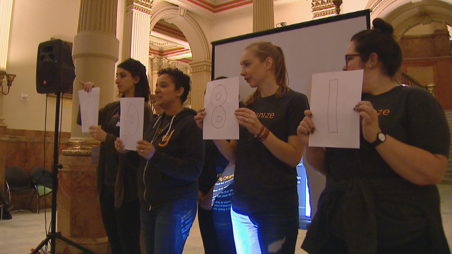 Galvanize teachers lead a demonstration of a simple sorting algorithm. (credit CBS)