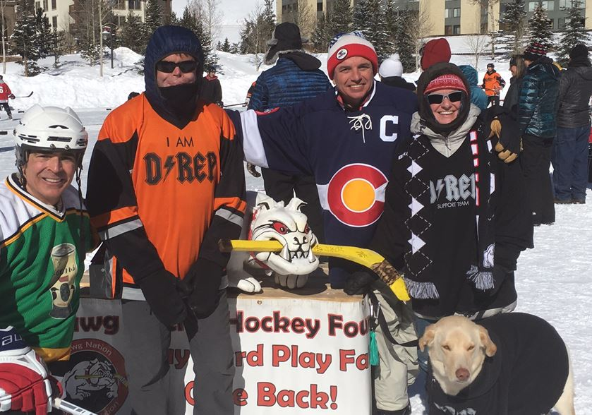 CBS4's Alan Gionet, Dave Repsher, Dawg Nation Hockey President Martin Richardson and Amanda Repsher with Dave and Amanda's dog (credit: CBS)