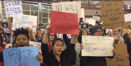 Travel ban protesters gathered Jan. 28 at Denver Int'l Airport. (credit:: CBS)