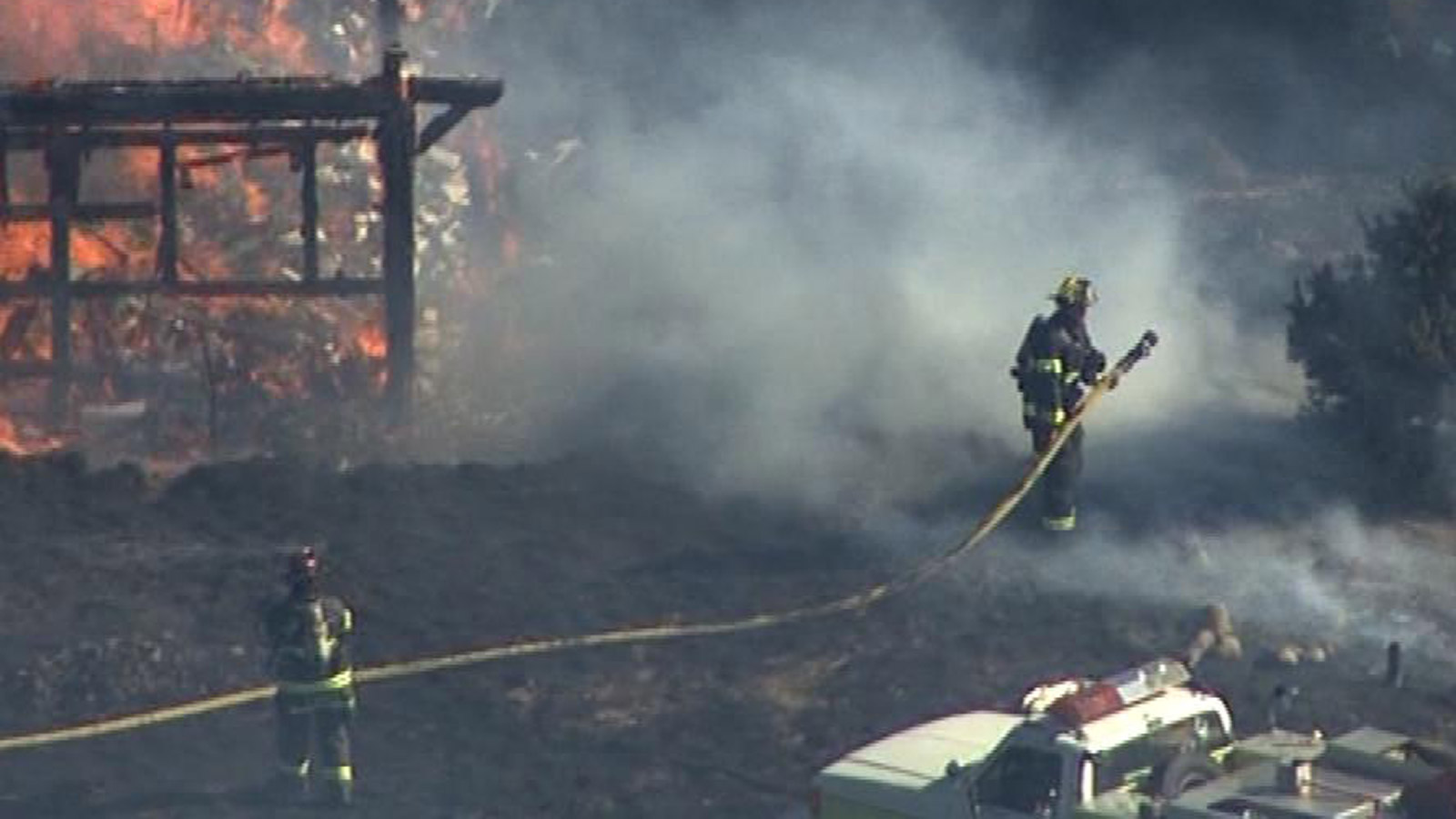 An image from Copter4 over a fire on Monday in Weld County that destroyed a structure (credit: CBS)