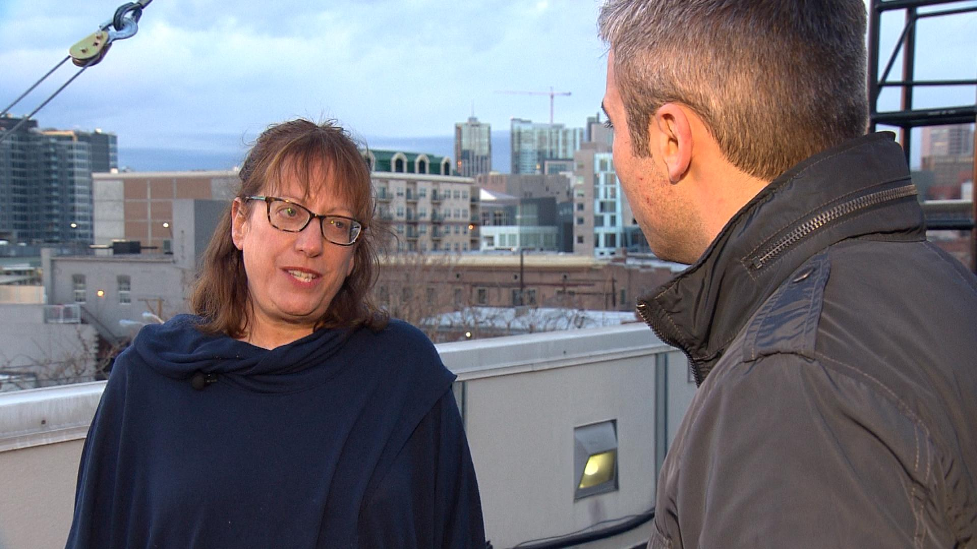 Eve Rose, an organizer with Indivisible Front Range Resistance, is interviewed by CBS4's Stan Bush (credit: CBS)