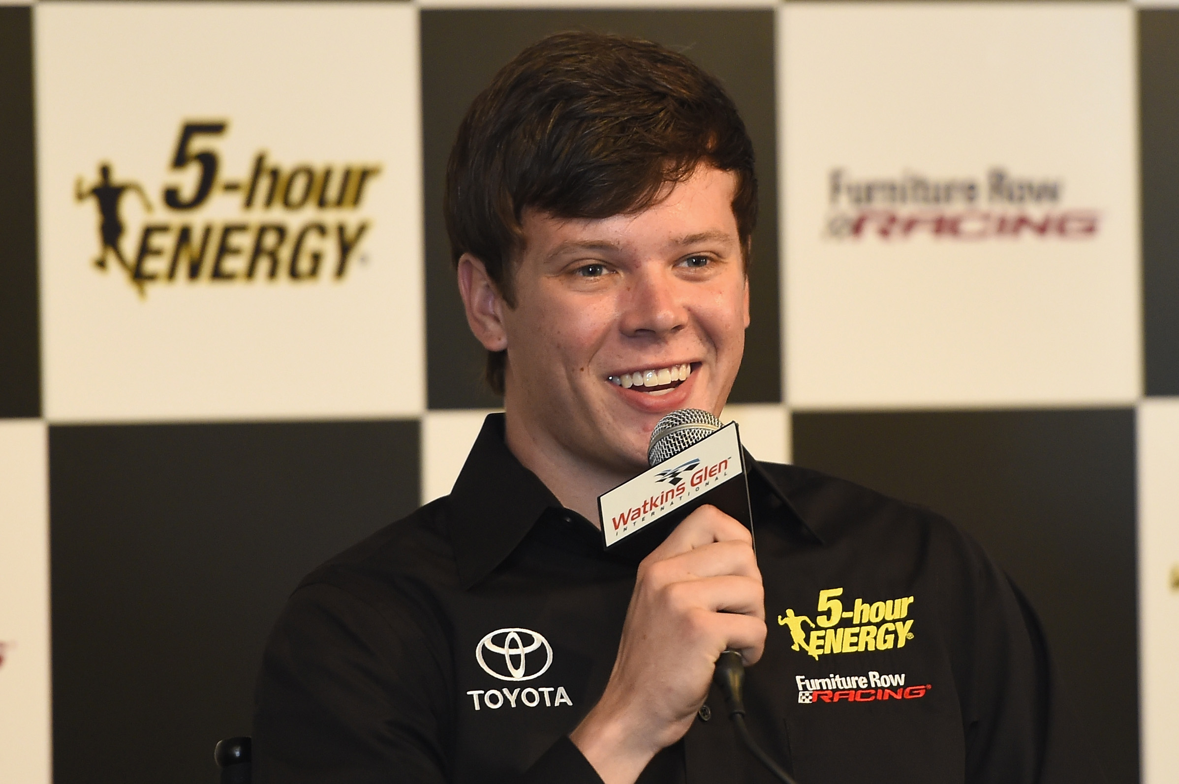 Erik Jones speaks to the media after announcing he will drive the #77 5 -hour Energy Toyota for Furniture Row Racing in 2017 prior to the NASCAR Sprint Cup Series Cheez-It 355 at Watkins Glen International on August 7, 2016 in Watkins Glen, New York. (credit: Josh Hedges/Getty Images)