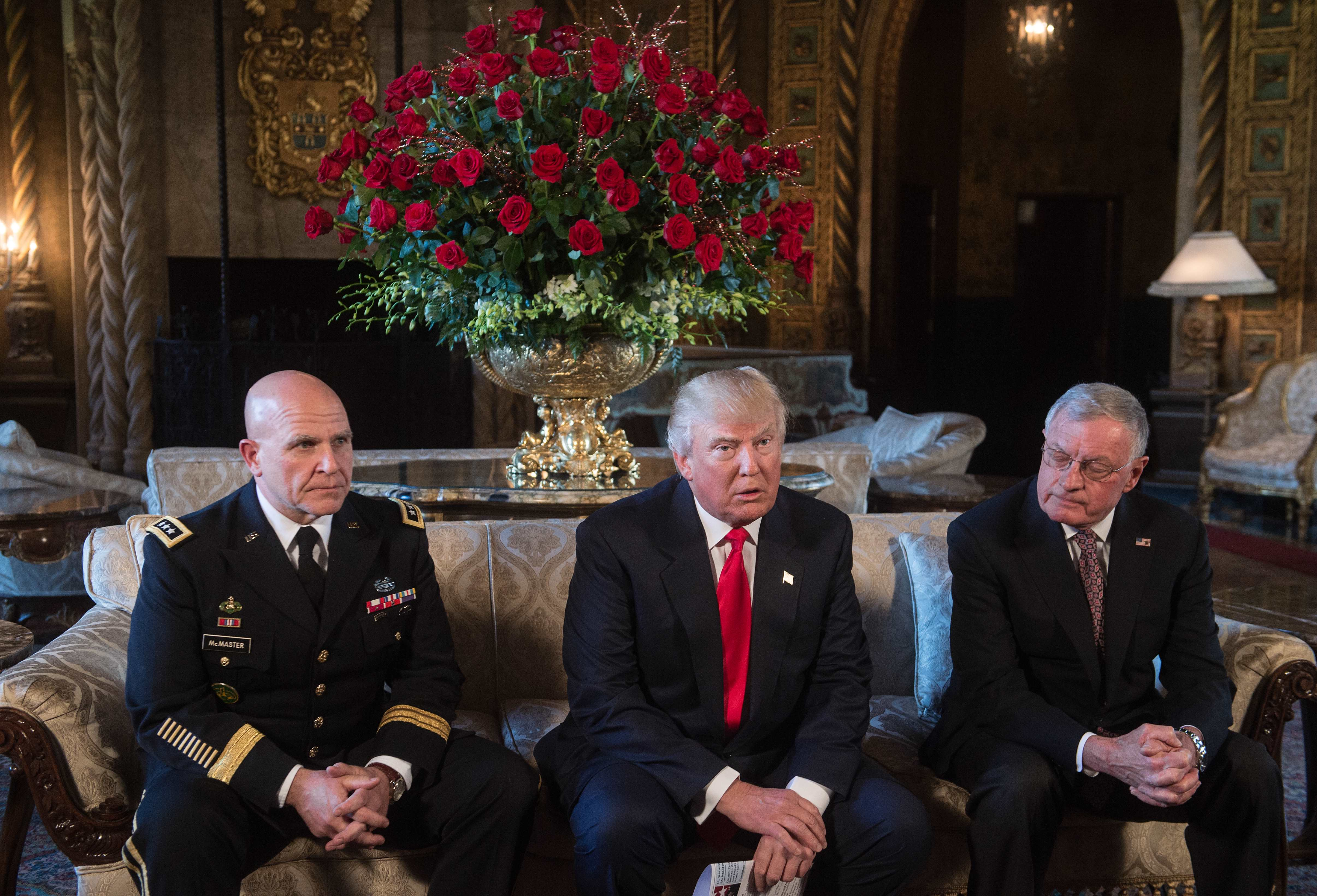 US President Donald Trump (C) announces US Army Lieutenant General H.R. McMaster (L) as his national security adviser and Keith Kellogg (R) as McMaster's chief of staff at his Mar-a-Lago resort in Palm Beach, Florida (credit: NICHOLAS KAMM/AFP/Getty Images)