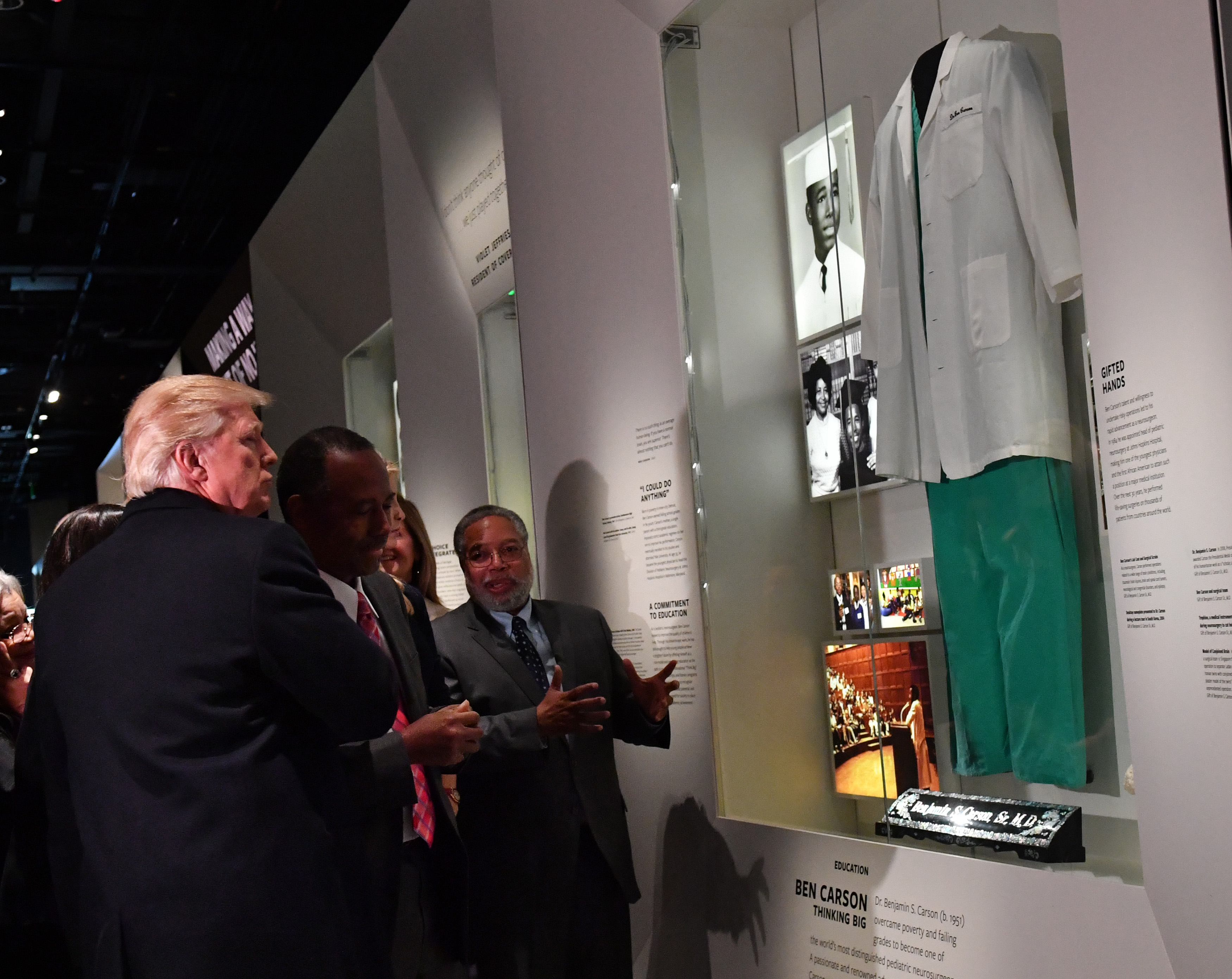 President Donald Trump and Housing and Urban Development nominee Ben Carson look at the Ben Carson exhibit at the Smithsonian National Museum of African American History and Culture   (Photo by Kevin Dietsch - Pool/Getty Images)