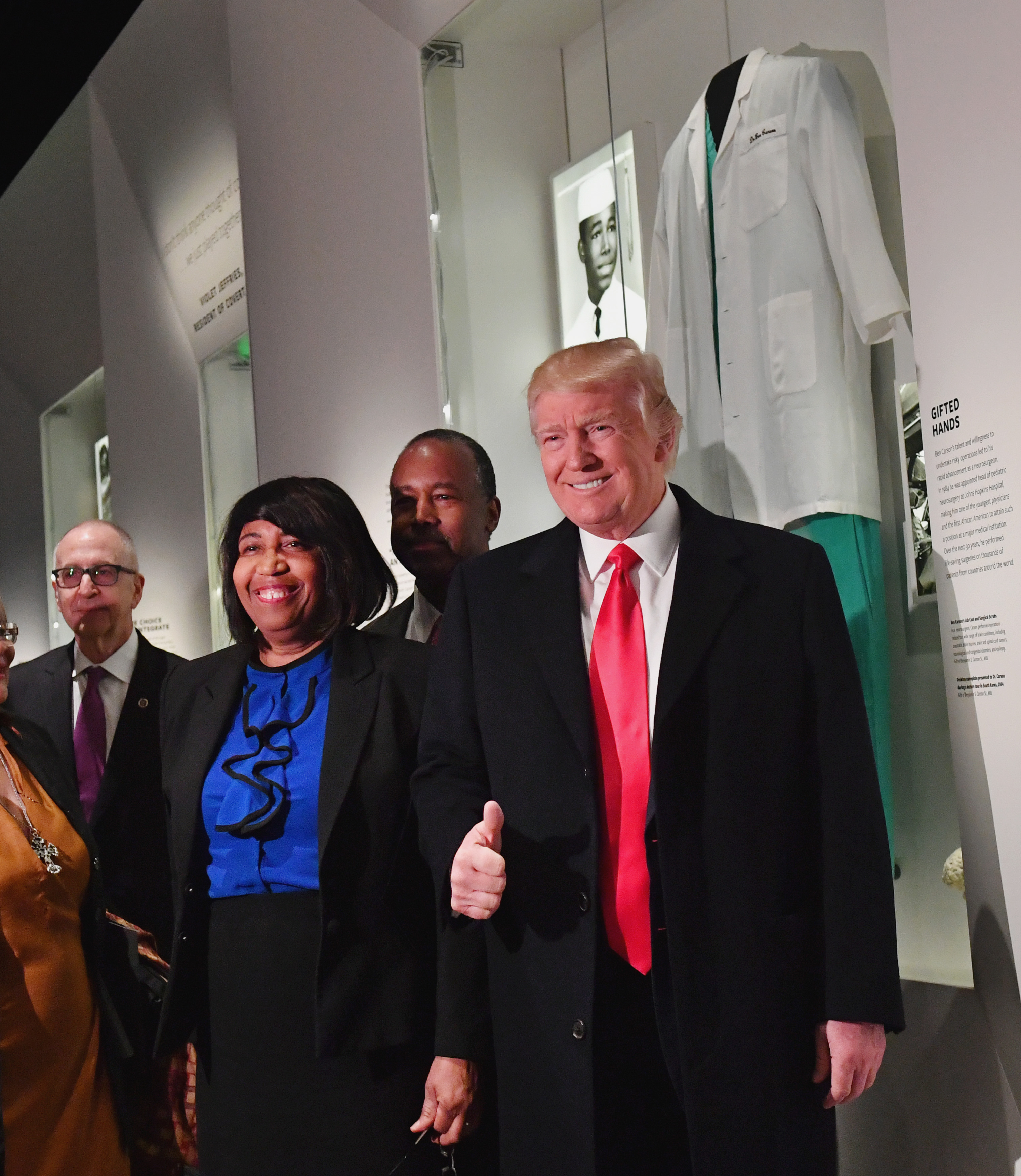 President Donald Trump, Ivanka Trump and Housing and Urban Development nominee Ben Carson pose in front of the Ben Carson exhibit during a visit to the Smithsonian National Museum of African American History and Culture (Photo by Kevin Dietsch - Pool/Getty Images)