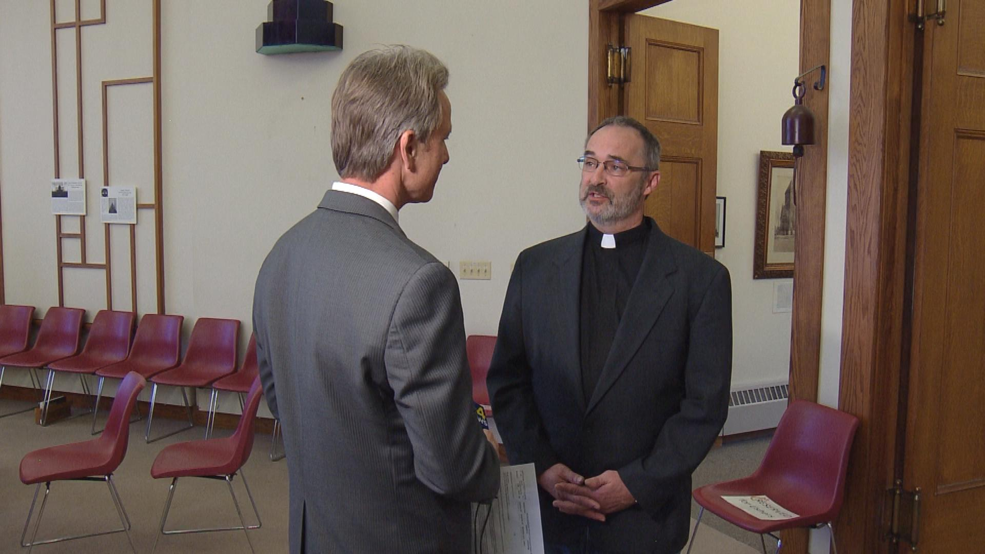 CBS4's Tom Mustin interviews Rev. Mike Morran (credit: CBS)